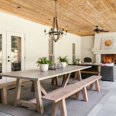 Farmhouse porch idea in Atlanta with a fire pit and a roof extension