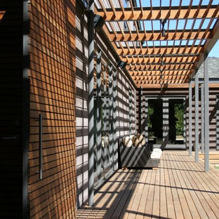 This is an example of a modern porch design in San Francisco with decking.