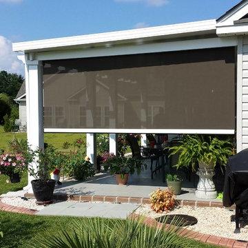 Motorized porch shades