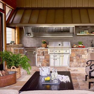 Mountain style outdoor kitchen porch idea in Raleigh