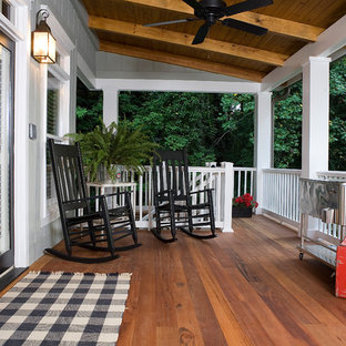 Classic porch idea in Atlanta with decking and a roof extension