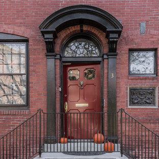 Esempio di un portico vittoriano di medie dimensioni e davanti casa con lastre di cemento e un tetto a sbalzo
