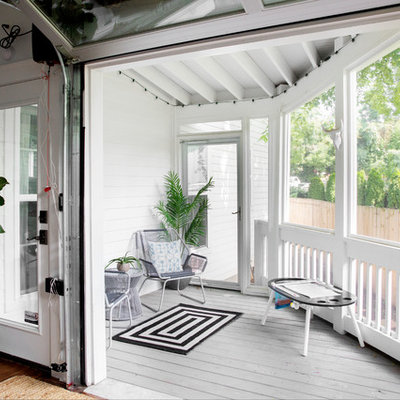 Cottage screened-in back porch photo in Nashville with decking and a roof extension