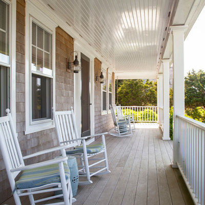 Large beach style front porch photo in Boston with decking and a roof extension