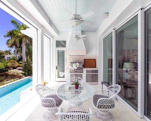 home building design ideas. coastal outdoor kitchen porch idea in miami with a roof extension home building design ideas