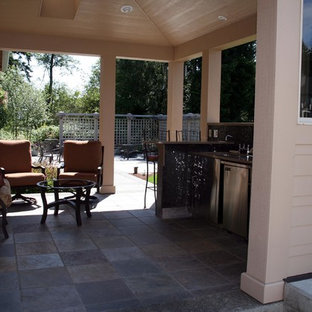 This is an example of a craftsman stone porch design in Seattle.