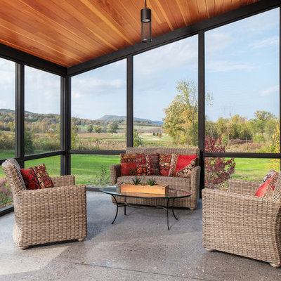 Inspiration for a mid-sized cottage concrete screened-in side porch remodel in Burlington with a roof extension