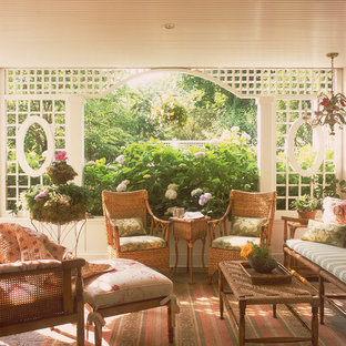 Inspiration for a mid-sized victorian screened-in back porch remodel in New York with a roof extension
