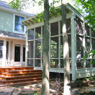 This is an example of a contemporary screened-in back porch design in Detroit.