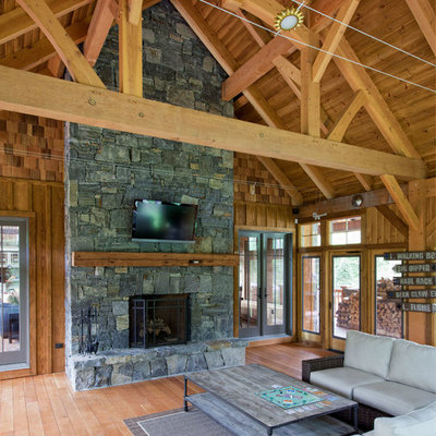 Inspiration for a mid-sized rustic side porch remodel in Burlington with a fire pit, decking and a roof extension