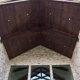 This is an example of a transitional porch design in Houston.