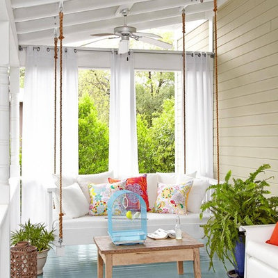 Cottage front porch idea in Los Angeles with decking and a roof extension