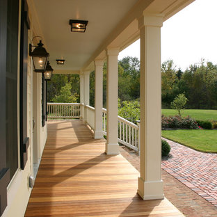 Elegant porch photo in Columbus with decking and a roof extension