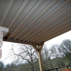 Traditional Porch by Shelter Solutions LLC