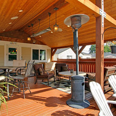 Traditional Porch by Rod Nicholas Finishing Touch