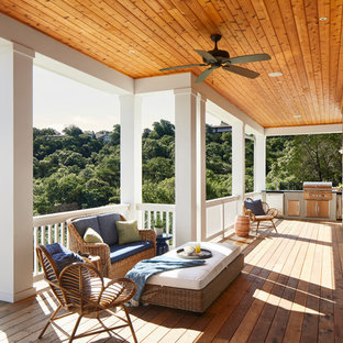 Huge coastal porch idea in Austin with a roof extension and decking