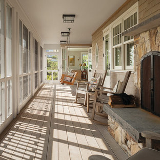 Inspiration for a large victorian side porch remodel in Other with a fire pit, decking and a roof extension