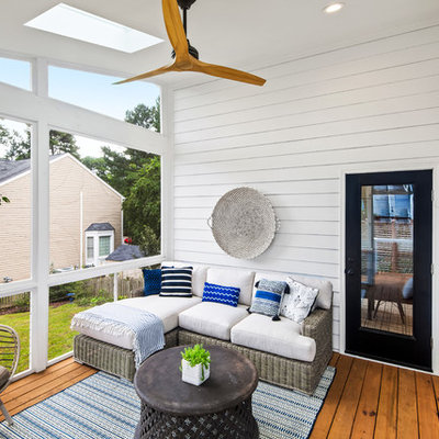 Inspiration for a country porch remodel in Raleigh with decking and a roof extension