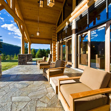 Rustic Porch by Sticks and Stones Design Group Inc
