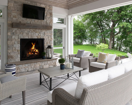 Inspiration For A Transitional Stone Porch Remodel In Minneapolis With A  Fire Pit And A Roof
