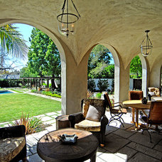 Mediterranean Porch by Tommy Chambers Interiors, Inc.