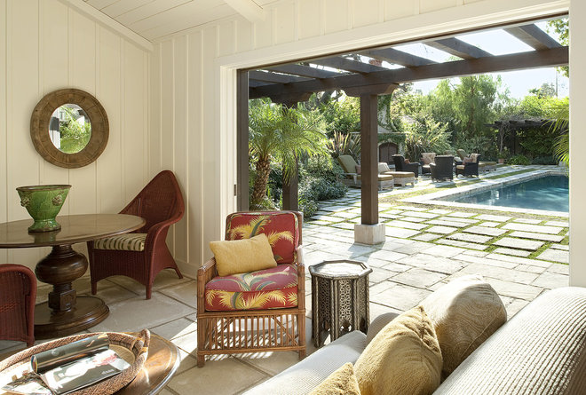 Rustic Porch by Tommy Chambers Interiors, Inc.
