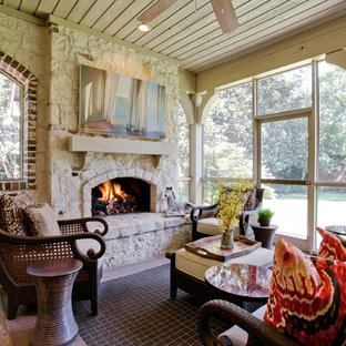 Elegant porch photo in Dallas with a fire pit and a roof extension