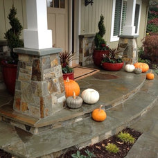 Traditional Porch by Garden LIghts Landscape and Pool Development Inc.