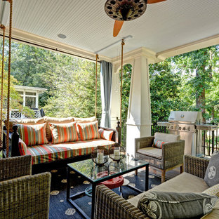 Inspiration for a large timeless back porch remodel in Atlanta with a roof extension and decking