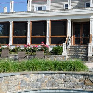 Foto di un ampio portico boho chic dietro casa con pavimentazioni in pietra naturale