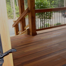 Rustic Porch by The Green Construction Company