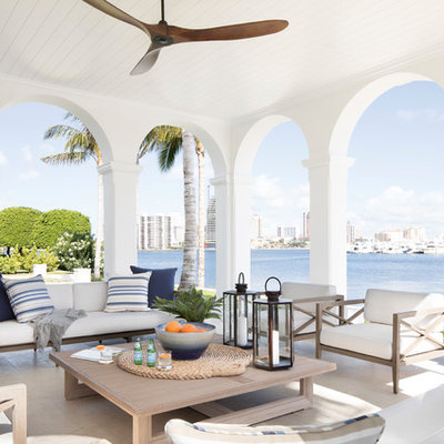 Beach style tile porch photo in Miami with a roof extension