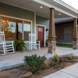 Large arts and crafts concrete front porch idea in Austin with a roof extension