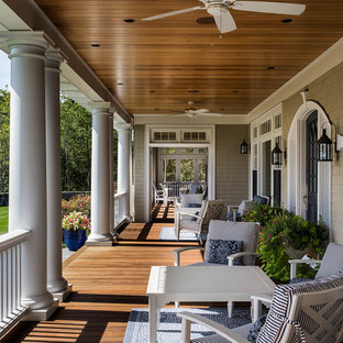 Elegant porch photo in Portland Maine with decking and a roof extension
