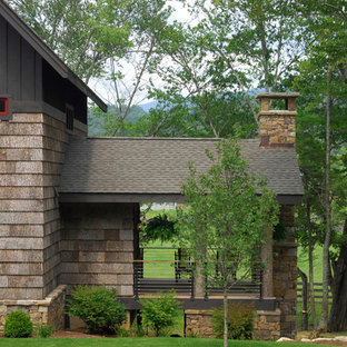 This is an example of a rustic porch design in Charlotte with decking.