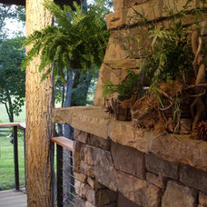 Rustic Porch by Christopher Kellie Design Inc.