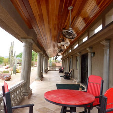 Mediterranean Porch Patio with Cement Columns and Redwood Ceiling