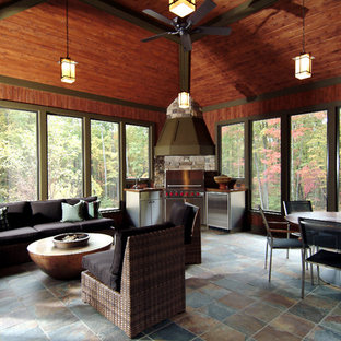 Classic porch idea in Grand Rapids with a fire pit