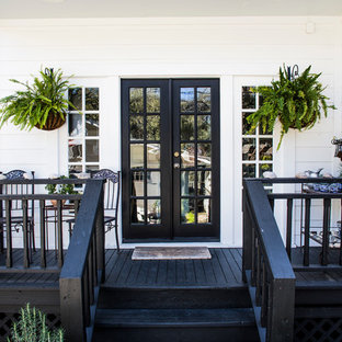 Classic porch idea in Austin with decking and a roof extension