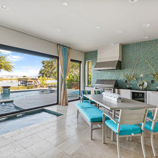 Mediterranean veranda in Orlando with an outdoor kitchen and a roof extension.