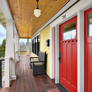Design ideas for an arts and crafts verandah in Seattle with decking and a roof extension.