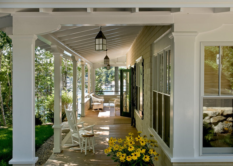 Wraparound porches with columns have curb appeal covered for Beach house designs with wrap around porch