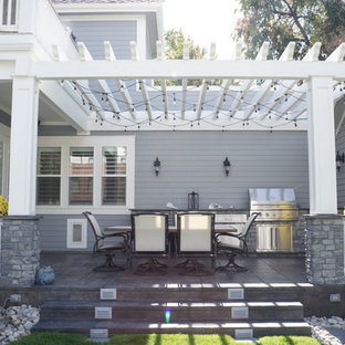 Design ideas for a medium sized victorian back veranda in Denver with an outdoor kitchen, concrete slabs and a pergola.