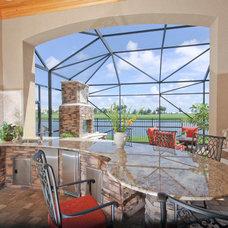 Mediterranean Porch by Christopher Burton Homes, Inc.