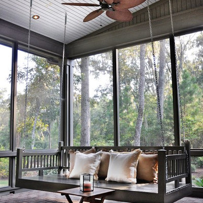 Classic brick screened-in porch idea in Atlanta with a roof extension