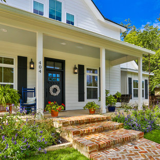 Inspiration for a mid-sized timeless concrete porch remodel in Austin with an awning