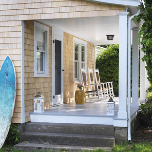 Coastal porch idea in Providence with decking and a roof extension