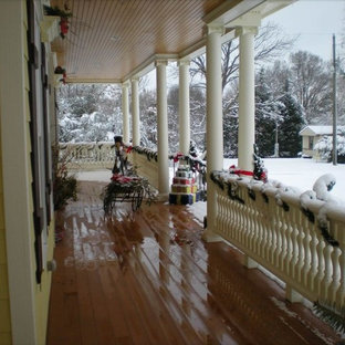 This is an example of a traditional front porch design in Raleigh with a roof extension.