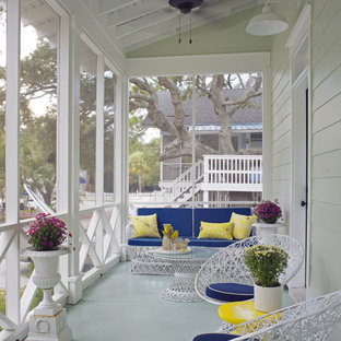 Inspiration for a mid-sized beach style concrete screened-in front porch remodel in Atlanta with a roof extension