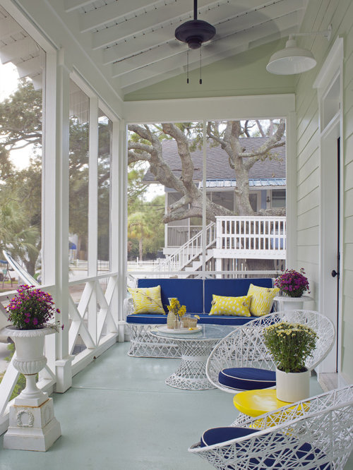 Inspiration For A Mid Sized Beach Style Concrete Screened In Front Porch  Remodel In